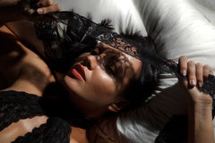 Woman in black guipure lingerie Stock Photography