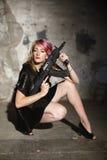Woman in black with gun Stock Photos