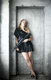 Woman in black with gun Royalty Free Stock Image