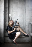 Woman in black with gun Stock Photos