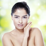 Woman with black hair and clean skin Stock Images