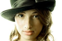 Woman with black hat Royalty Free Stock Photography