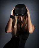 Woman in black hat Stock Image