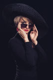 Woman in black  hat Royalty Free Stock Photos