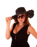 Woman in black hat and black dress stock photo