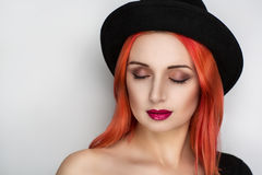 Woman with black hat. Closeup portrait of beautiful girl with red fire hair styling. Luxury orange combed hair. Good new photo for advertising shampoo Royalty Free Stock Images