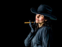 Woman in Black Hat and Dress with Cigar Royalty Free Stock Images