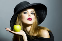 Woman in black hat Stock Images