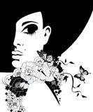 Woman in a black hat with flowers and butterflies Stock Images
