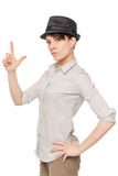 Woman in black hat keeps fingers gun Stock Photography