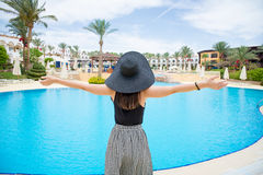 Woman in black hat near the pool Royalty Free Stock Photo