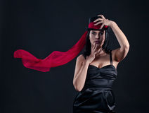 Woman in black hat with red scarf Royalty Free Stock Photography