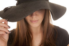 Woman black hat touch close up Stock Image