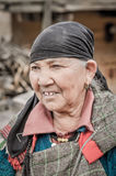 Woman with black headcloth in Himachal Pradesh. Manali, Himachal Pradesh - circa November 2011: Old woman with black headcloth and dressed in layers of clothes Royalty Free Stock Image