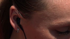 Woman with black headphones listening music stock video footage