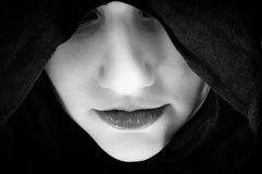 Woman with black hood Stock Image