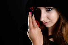 Woman in black hood Royalty Free Stock Images