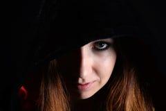 Woman in black hood Royalty Free Stock Image