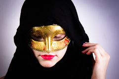 Woman in black hood and red lips Royalty Free Stock Photos