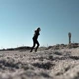 Woman in Black Hoodie and Skinny Jeans in Sandy Field Stock Photo