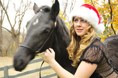 Woman with a black horse Royalty Free Stock Photography