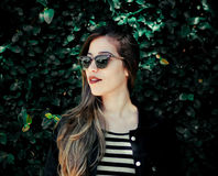 Woman in Black Jacket and Black Sunglasses Royalty Free Stock Image