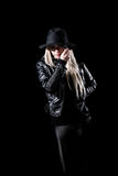 Woman in a black jacket and a hat Royalty Free Stock Photo