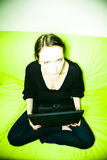 Woman in black with laptop Royalty Free Stock Image