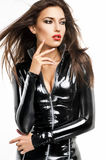 Woman in black latex costume Stock Images