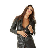 Woman in black leather coat Stock Photography