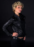 Woman in black leather fashion clothes. Woman with short blond curly hair in black leather clothes Royalty Free Stock Photography