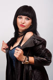 Woman in black leather jacket Stock Image