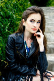 Woman in black leather jacket Stock Photos
