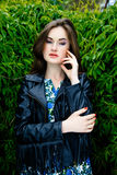 Woman in black leather jacket Royalty Free Stock Images