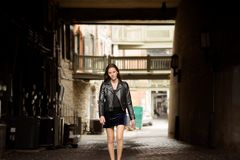 Woman in Black Leather Jacket and Skirt Royalty Free Stock Image