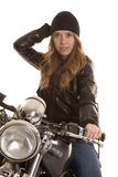 Woman black leather motorcycle hand on hat Royalty Free Stock Photo