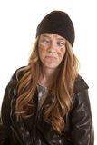 Woman black leather mud on face cross eyed Stock Photo