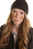 Woman black leather mud on face mad Stock Image