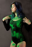 Woman in Black Leotard Covered in Green Poweder Stock Photography