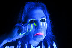 Woman black light cry Stock Image