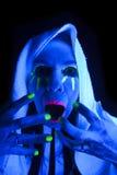 Woman black light towel scream Stock Image