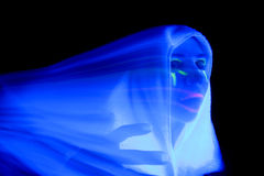 Woman black light white ghost Stock Images