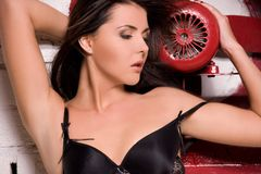 Woman in black lingerie with big red fan Royalty Free Stock Images