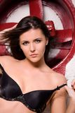 Woman in black lingerie with big red fan Stock Photos