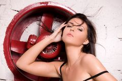 Woman in black lingerie with big red fan Stock Photography