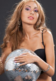 Woman in black lingerie with disco ball Royalty Free Stock Photo