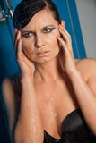 Woman in black lingerie dripping water Stock Images