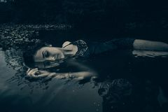 Woman in Black Lingerie Laying on Body of Water Royalty Free Stock Photos