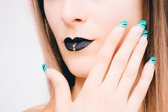 Woman With Black Lipstick and Teal Nail Polish stock photos