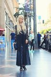 Woman in Black Long Dress Standing on the Pavement Royalty Free Stock Photo